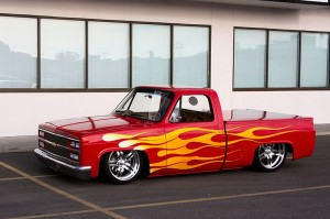 1985_Chevrolet_C10_-_Red_Rocker_(3883436904)