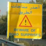 800px-UAE_Beware_of_road_surprises_-_Flickr_-_woody1778a