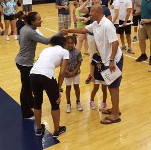 Stevie Mussie shakes hands with James Franklin
