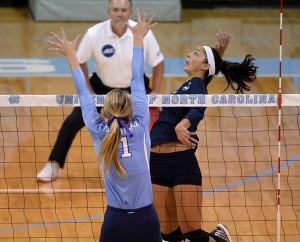 Junior Nicole Lott rises for one of her 17 kills Friday against North Carolina