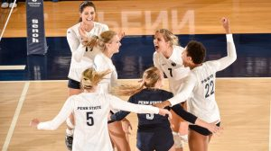 The Nittany Lions celebrate a point during the game with West Virginia. No. 9 Penn State women's volleyball opened the 2016 season with a sweeping 3-0 (25-13, 25-13, 25-17) win against West Virginia Friday evening at Rec Hall. Photo by Mark Selders